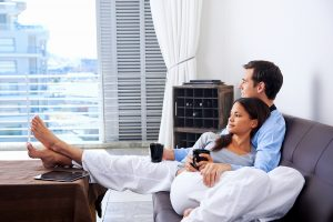 bigstock-Couple-relax-at-home-with-cup-44753494